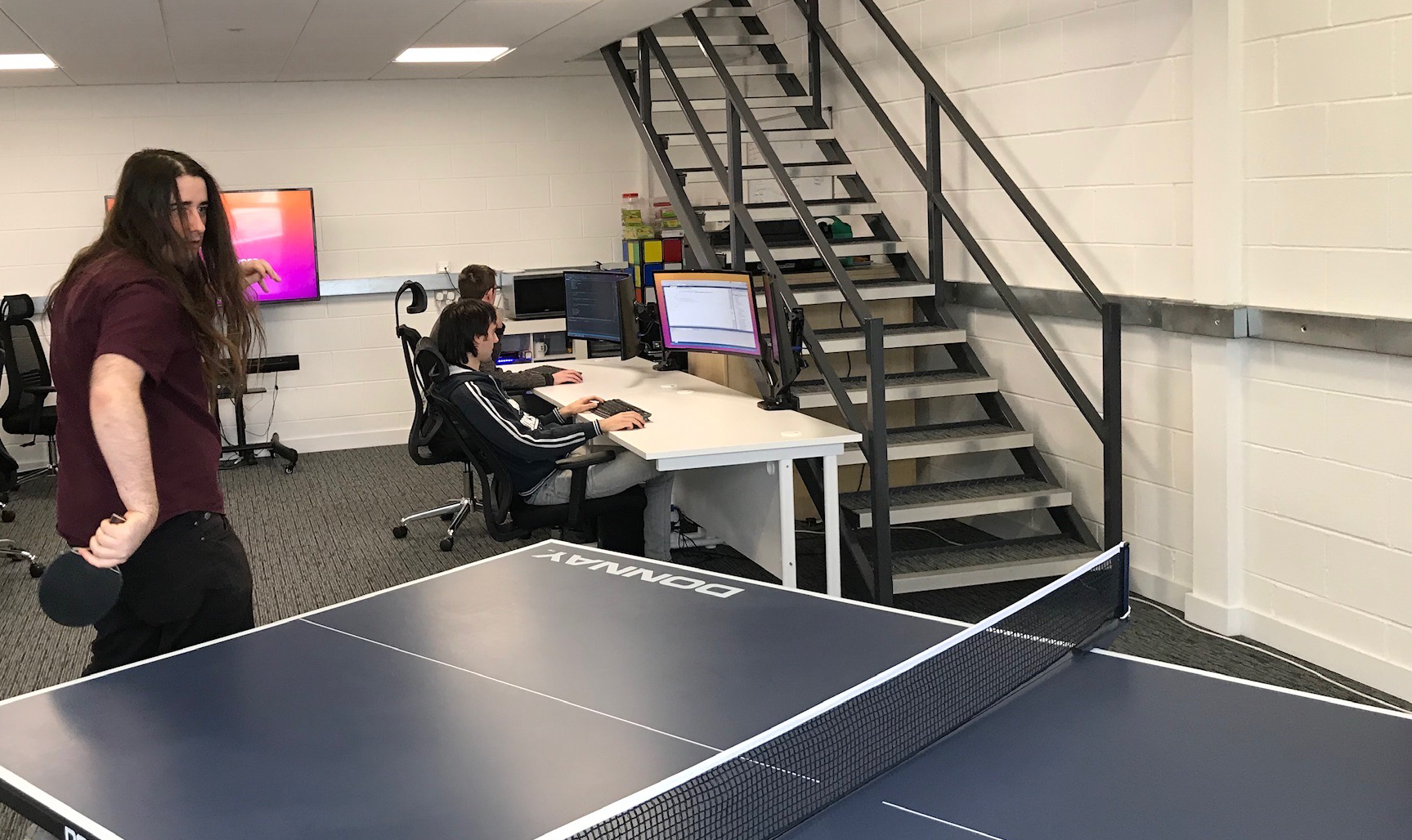 Software Developer Ollie Playing Table Tennis