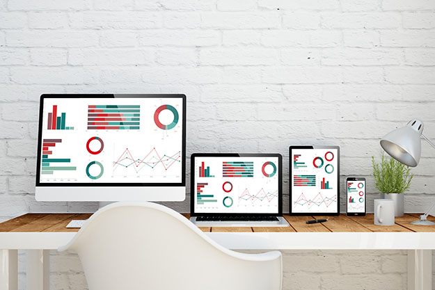 Computers and Tablets Showing Data Analytics Thumb