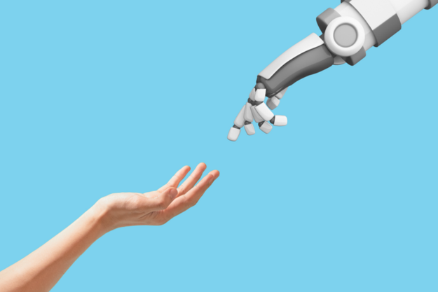 Human Hand and Robot Hand reaching out to touch